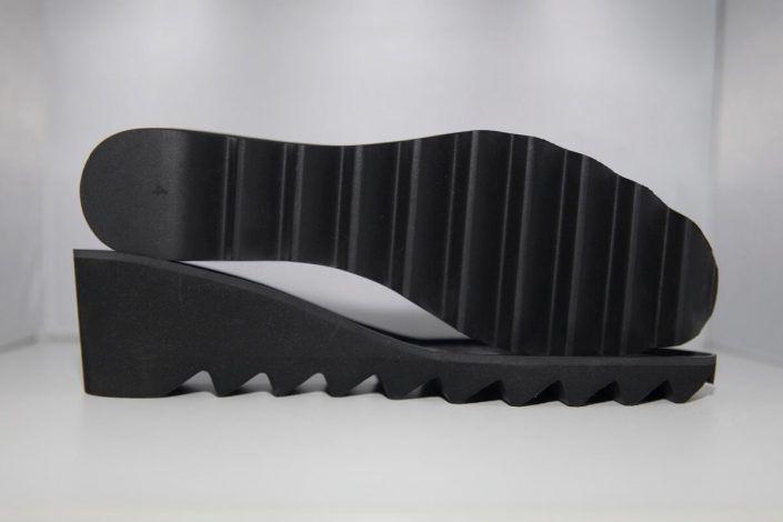 Fabricación de pisos y suelas para calzado.